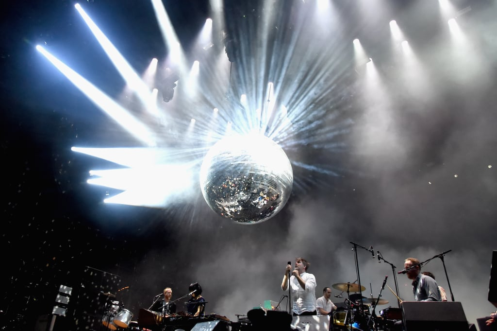 LCD Soundsystem performing under a massive disco ball in 2016.