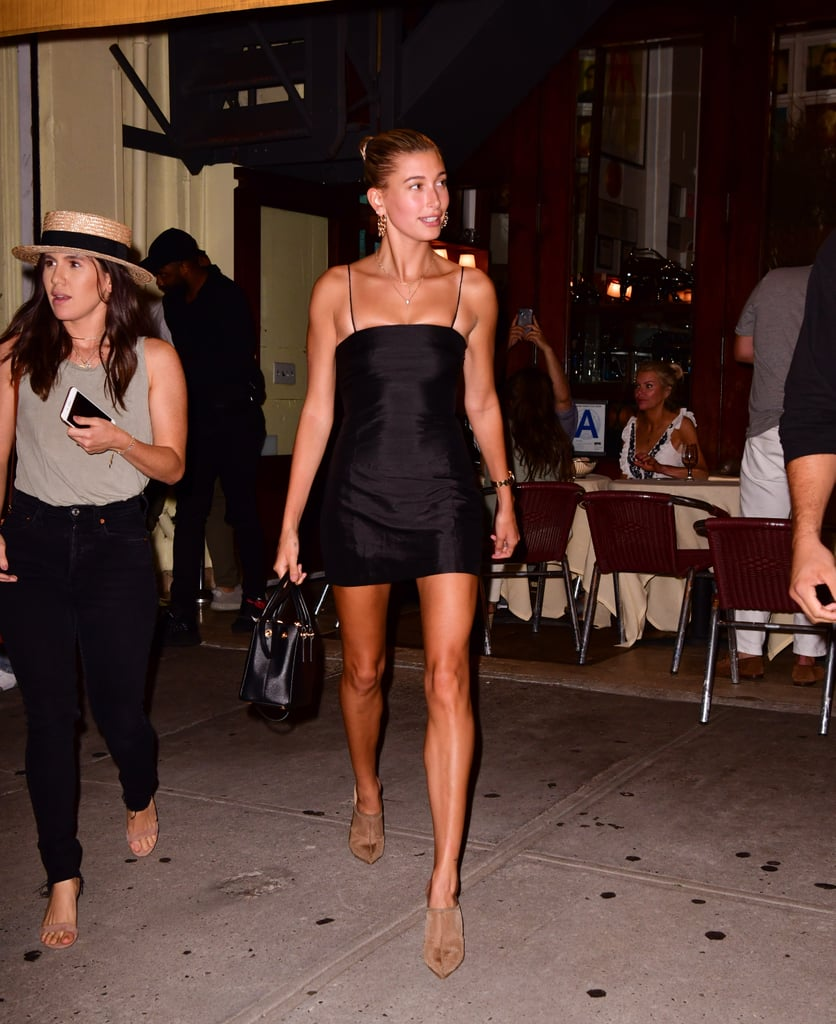 "Hailey owns this Réalisation Par LBD in both black and white. She styled the ""Posh version"" with tan Yeezy mules for a night out in NYC in mid-August."