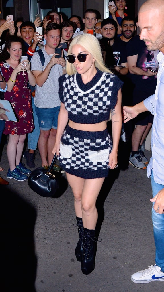 Platinum blonde Gaga sporting a sexy checkered two-piece ensemble. Her Giuseppe Zanotti platform boots really complete the look.