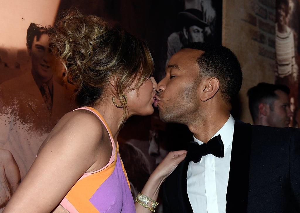 They shared a celebratory kiss at the Governors Ball after John won an Academy Award in February 2015.