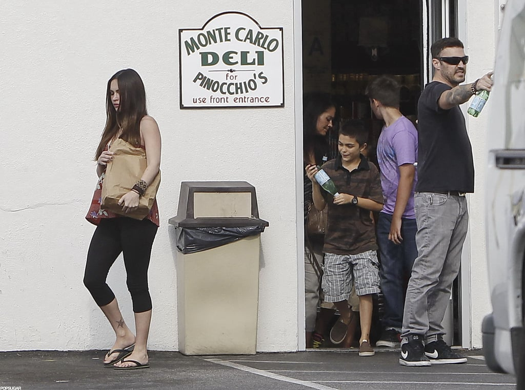 Pregnant Megan Fox carried a brown bag out of a deli in LA.