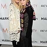 Twinning combo: A little crochet never hurt anyone. The girls celebrated the launch of MARKTBeauty.com in lots of boho-chic layers.   Mary-Kate softened her black leather look with a cream-colored crochet wrap.  Ashley wrapped a multicolored crocheted scarf over her white-and-black look.