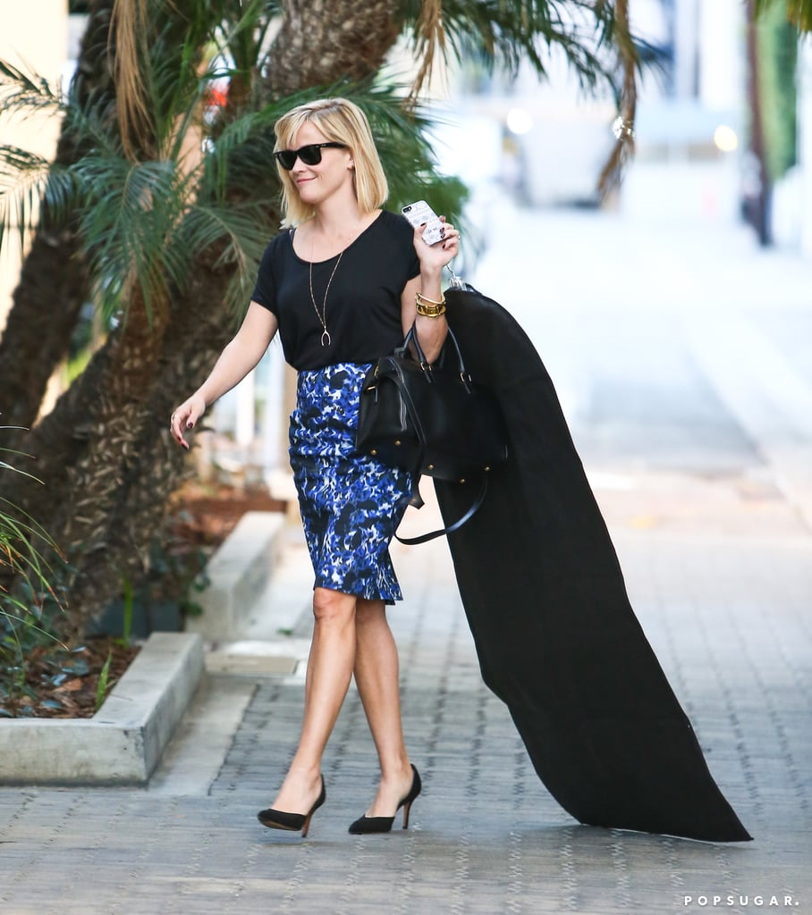 Reese Witherspoon carried a garment bag almost as tall as her in LA on Thursday.