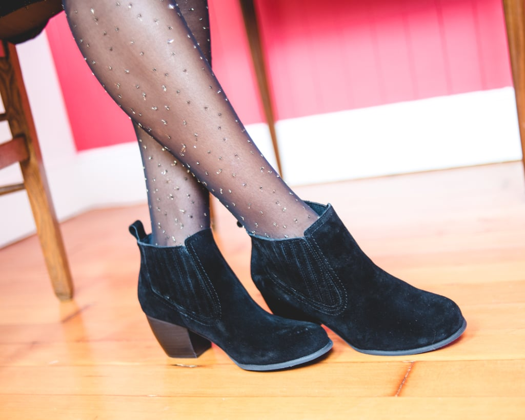 """These black booties have a heel that's both flattering and reasonable for the office.    Shop Gifts For """"the Working Girl"""":    Parisienne and Again Tunic   Alpaca to Omega Sweater   A Glitter Bit Louder Now Tights   Have Style, Will Travel Bag in Latte   That'll Do the Kick Bootie"""