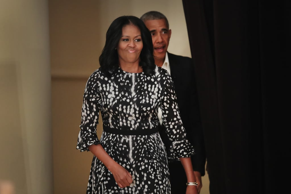 Former First Lady Michelle Obama might not be dressing for an audience anymore, but that doesn't mean we'll stop looking. Michelle attended a community event with former President Barack Obama, wearing a black and white spotted dress. A black band around the waist highlighted her silhouette while the three-quarter sleeves featured small ruffles at the elbows — to show off a David Yurman pearl and diamond bracelet. These tiny details on her dress made it stand out — one of the reasons we loved her looks so much in the past. Oh, Michelle Obama, we'll never get tired of seeing your style. Scroll on to see her look in full, then shop similar picks ahead.      Related:                                                                                                           The 30 Most Magnificent Gowns Michelle Obama Wore While in the White House