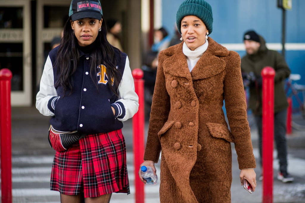 Give an updated take on the old school uniform with a pleated plaid skirt and varsity jacket.