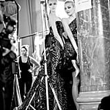 Models at Zuhair Murad pose as they prepare to walk.