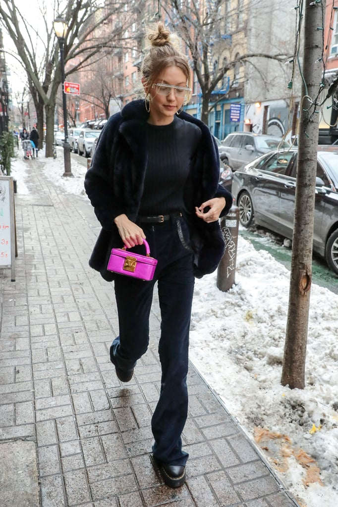 A little pop of pink from her Stalvey handbag brightened up Gigi's all-black outfit. She wore a Sézane coat while her corduroy pants and sweater were from Nina Ricci's Fall '17 collection. The star also accessorized with a pair of Le Specs x Adam Selman sunglasses and Dr Martens x Lazy Oaf boots.