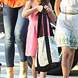Suri Cruise toted a white and black bag.