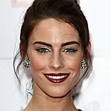 To add softness to your topknot, just add face-framing tendrils, like Jessica Lowndes shows here.