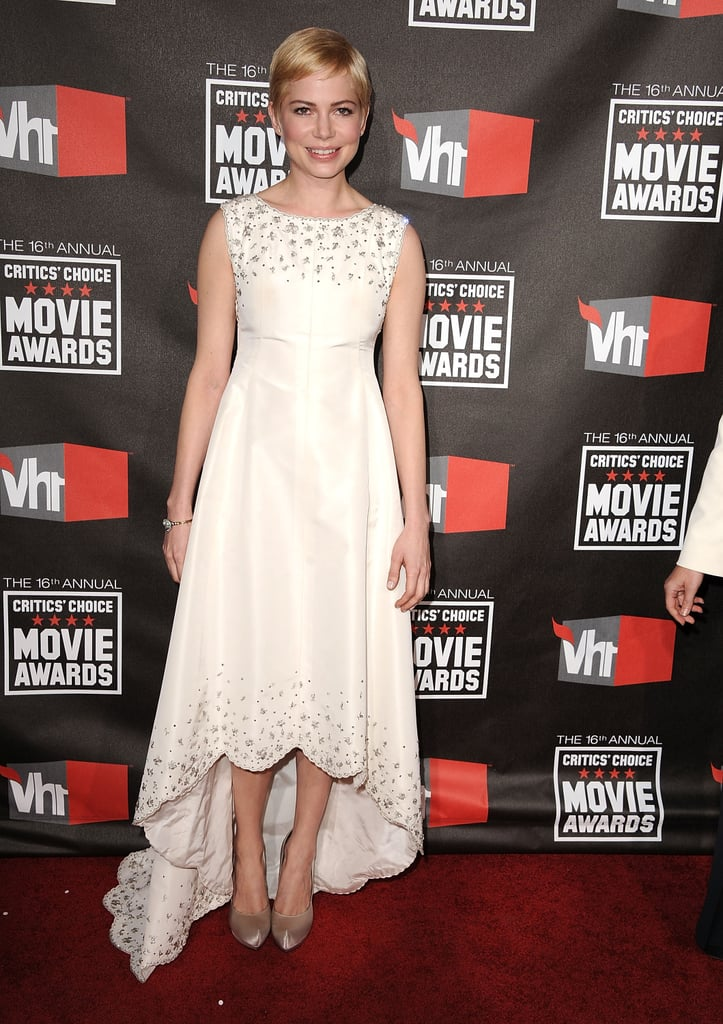 Michelle Williams chose a scalloped hem — not to mention a subtle high-low hem — with lots of embellishments for her appearance at the 2011 Critics' Choice Movie Awards.