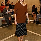 At the Christopher Kane show, Olivia's asymmetrical jumper gave her ladylike plaid skirt a contemporary twist.