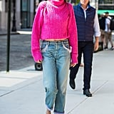 The master of brights, Gigi wore  a magenta turtleneck sweater from 3.1 Phillip Lim and Marc Jacobs jeans in Sept. 2017.