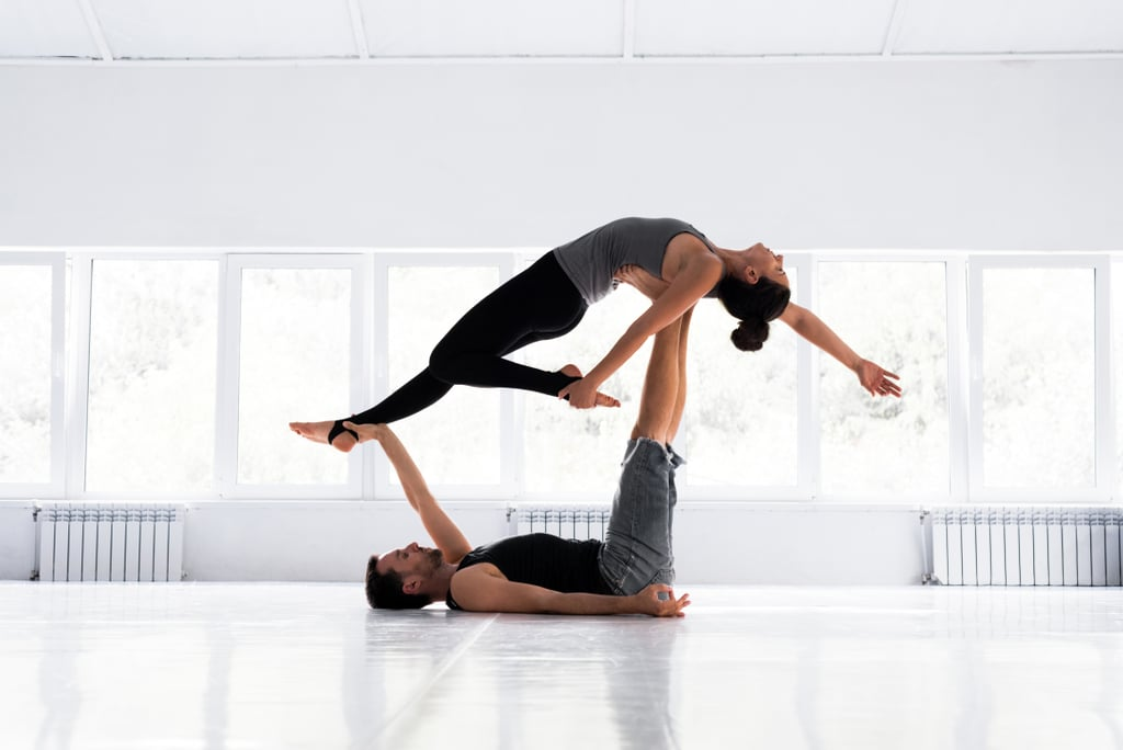 Try a Partner Yoga or Acro Yoga Class