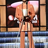 Presenting an award on stage at the 57th annual Grammy Awards in 2015.