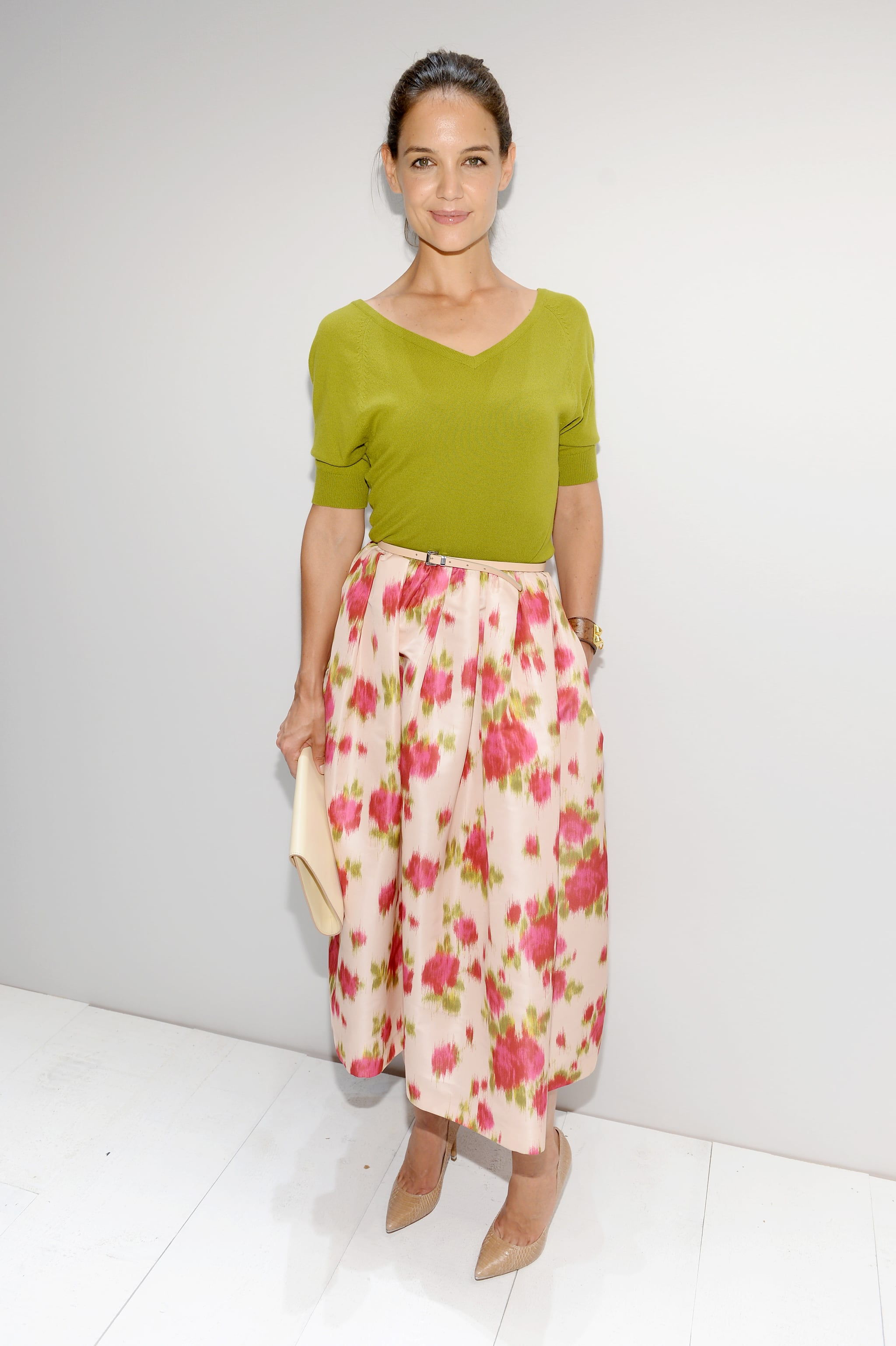 Katie Holmes was unmistakably feminine in a floral midi skirt at the Michael Kors Spring 2014 show.