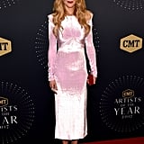 Nicole wearing a pink Versace dress at the 2017 CMT Artists of the Year Awards.