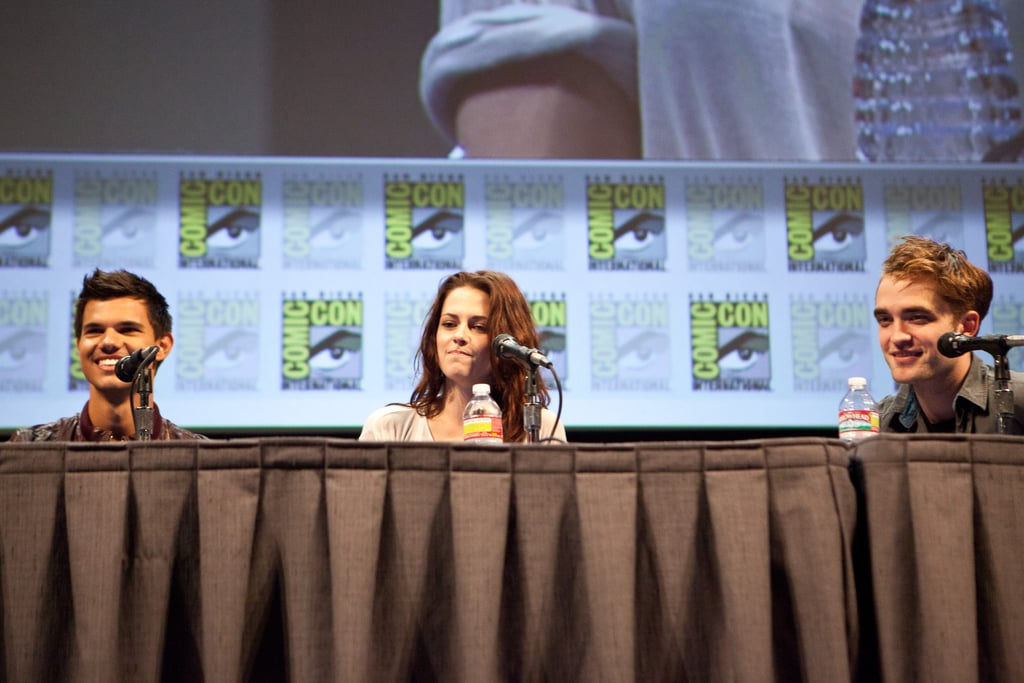 Kristen Stewart sat between Taylor Lautner and Robert Pattinson during a panel discussion in 2011.