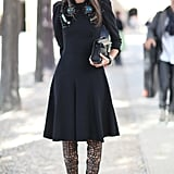 Mirrored shades and a pair of serious statement heels updated this embellished, ladylike dress with fashion-forward edge.