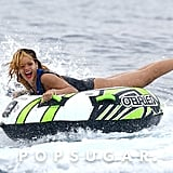 Rihanna rode in an inner tube that was being pulled by a boat.