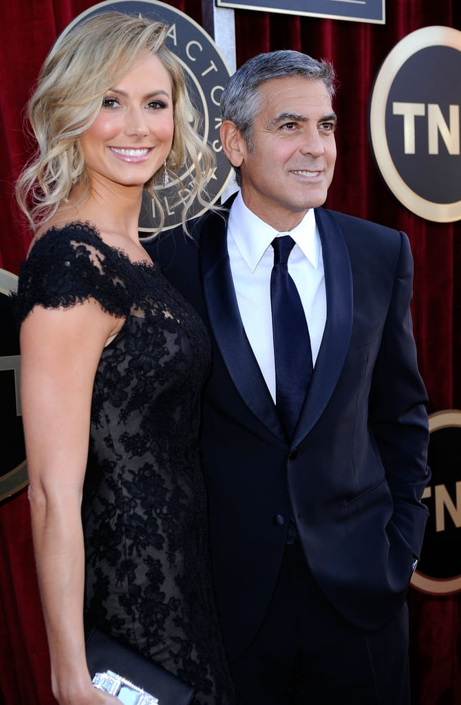 George Clooney and Stacy Keibler were together today on the red carpet at the SAG Awards in LA. She was decked out in a black dress from Marchesa, matching boyfriend George in his black and white tux. Stacy took a night off from awards season craziness on Saturday, when she skipped the Directors Guild of America Awards. George was there to honour his The Descendants director Alexander Payne along with co-star Shailene Woodley. Today could bring more honours to Alexander's movie if George walks away with a best actor statue. They're also in the running for best performance by an ensemble cast.