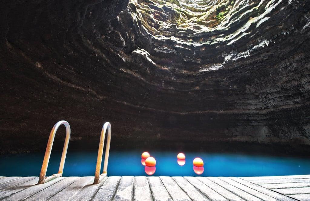 Do paddleboard yoga inside Utah's Homestead Crater.