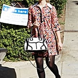 """Dianna Agron's """"I Voted"""" pin was camouflaged by her floral dress as she left her voting poll in LA."""