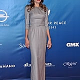 Angelina Jolie wore a long, gray gown to the Cinema for Peace gala.