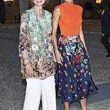 Queen Sofía in a Printed Tunic and White Trousers, August 2018