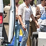 Zac Efron wore vintage acid washed jeans for his latest batch of scenes.