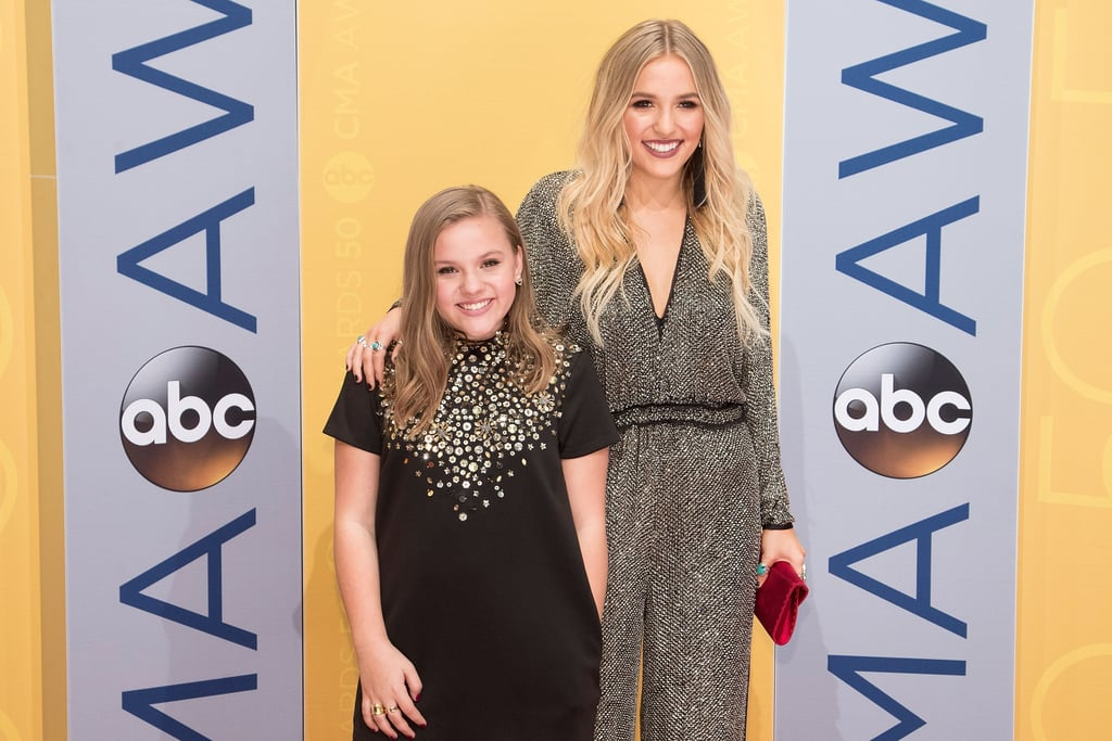 "Lennon and Maisy Stella are some of the cutest sisters in the music industry. The 20-year-old and 15-year-old musicians, respectively, got their big break playing sisters on Nashville back in 2012, and have been giving us sweet glimpses of their bond ever since. You might remember obsessing over their covers of Charli XCX's ""Boom Clap"" and Robyn's ""Call Your Girlfriend"" on YouTube.  Lennon has since risen to fame with her own solo music, but the sisters are still just as close as ever. Maisy has even appeared in handful of Lennon's music videos, including ""La Di Da,"" and jumps on stage with her from time to time. When they're not cheering each other on in their personal endeavours, they're sharing adorable moments together on social media. See some of their best pictures ahead."