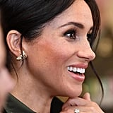 Meghan's gold and diamond butterfly earrings were a tribute to Princess Diana while in Sydney with Prince Harry. She borrowed these from the late princess's collection for her travels.