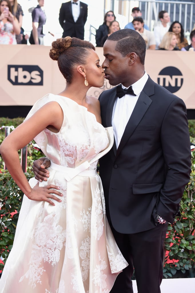 Sterling K. Brown and Ryan Michelle Bathe looked gorgeous, per usual, when they attended the SAG Awards on Sunday night. The couple showed some sweet PDA when they hit the red carpet in LA ahead of the event. While the two-time nominee donned a sharp black suit, his wife was absolutely stunning in a cream-coloured gown. Aside from looking like a real-life prom king and queen, they also showed off their swoon-worthy romance as they shared a few kisses for the cameras.