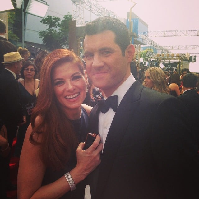 Comedian Billy Eichner must have said something to make Debra Messing laugh.