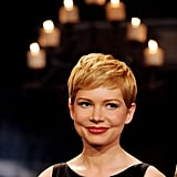 Michelle Williams topped off a wide-neck dress with her pretty pixie cut.