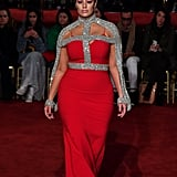 Turning heads on the runway wearing a gorgeous red and silver gown by Christian Siriano.