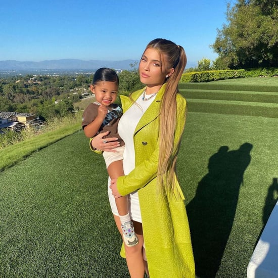 Kylie Jenner's Green Coat and White Minidress With Stormi
