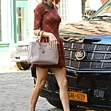 A collared check dress and booties highlighted Taylor's feminine flair.