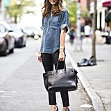 Olivia Palermo's denim popover gets all dressed up with black trousers and posh blue heels. Source: Le 21ème | Adam Katz Sinding