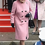 In March 2018, Queen Elizabeth II wore her trusty loafers with a pink coat and other black accessories.