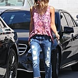 Jessica made her superdistressed bottoms seem elevated by pairing them with a pretty, patterned tank and sandals.