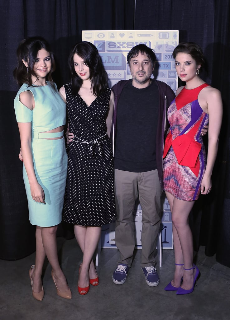 Selena Gomez posed alongside her Spring Breakers director and costar Ashley Benson at a cast photo op. Selena worked a cutout pastel Cushnie et Ochs sheath and Ashley chose an allover abstract-print mini with Monika Chiang electric blue pumps.