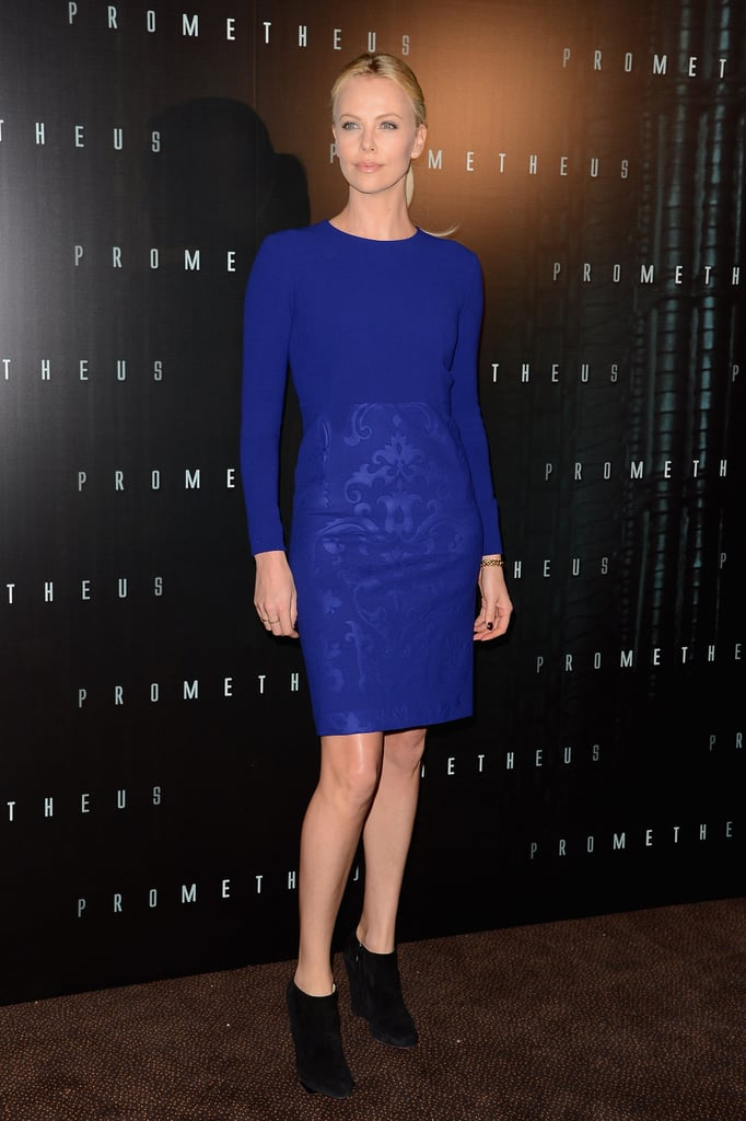 At the Prometheus Paris premiere, Charlize donned a cobalt blue Stella McCartney sheath with black booties.