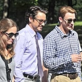 Susan Downey and Robert Downey Jr. walked with Chris Evans.