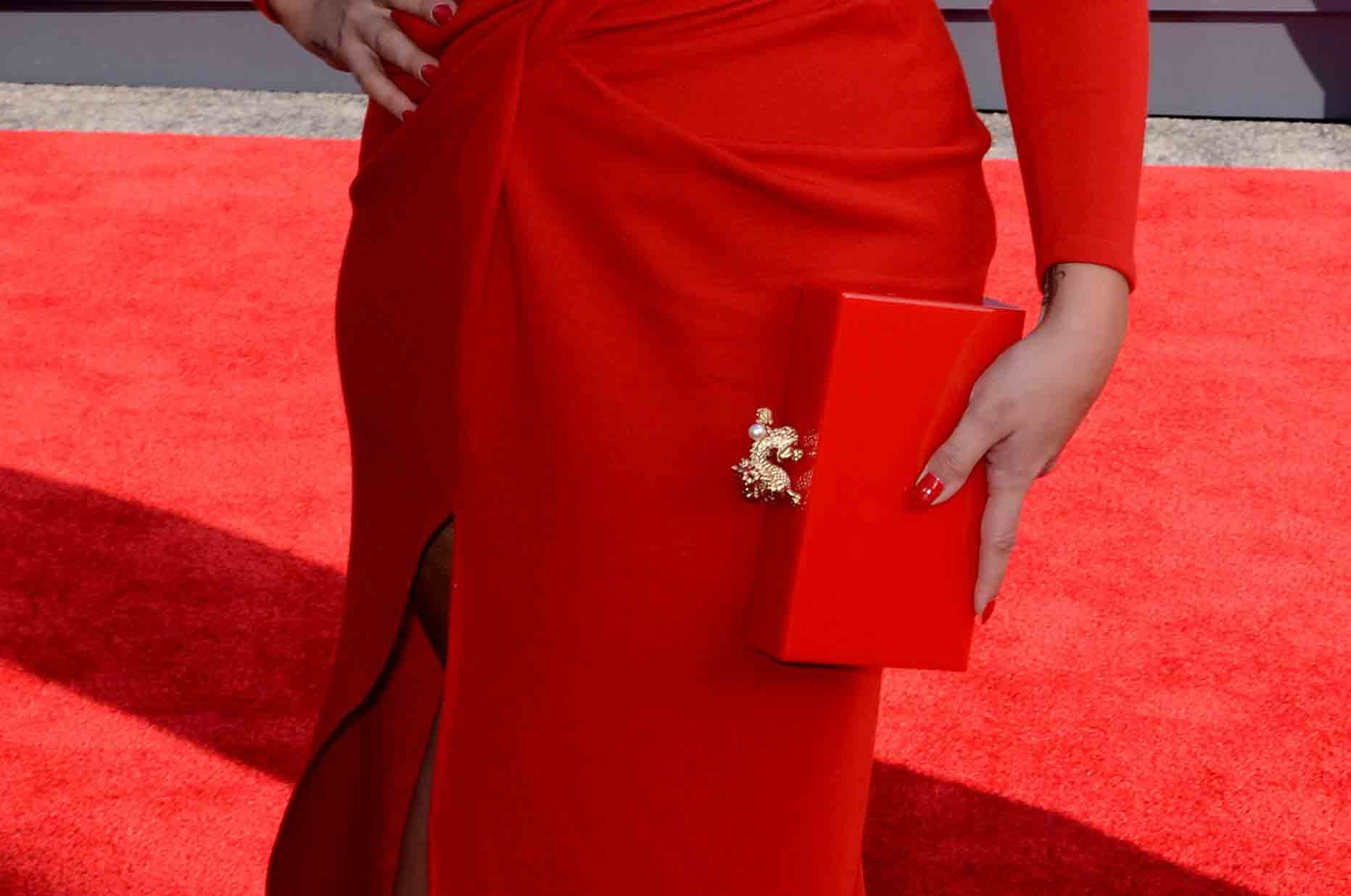 Demi Lovato's monochromatic look was complete with her ruby-red Charlotte Olympia clutch.