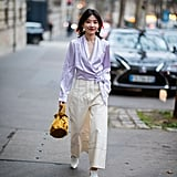 Experiment with texture: a colorful silk top is unexpected with cropped cotton pants.