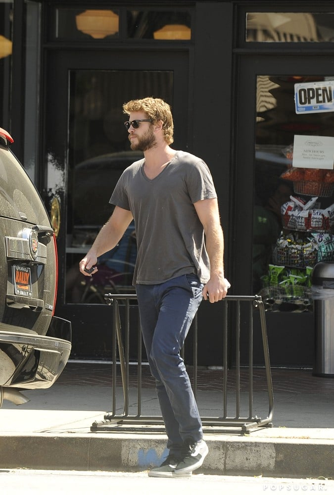 Liam Hemsworth sported facial hair while leaving lunch.
