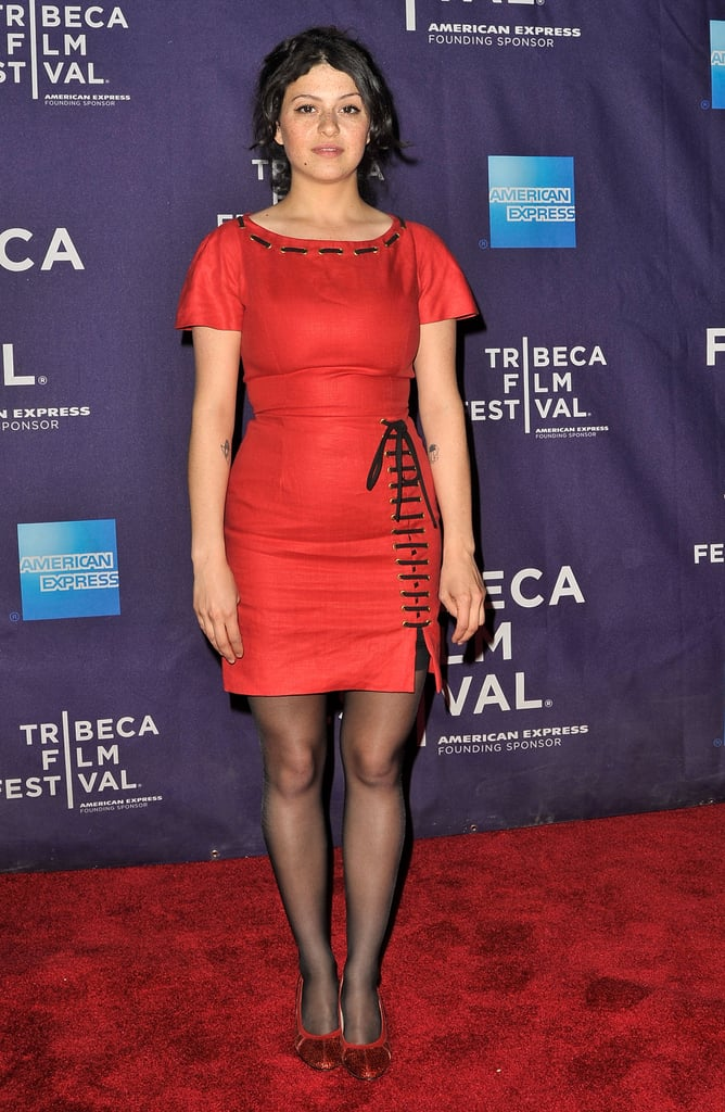 Alia Shawkat opted to wear a corset tie-embellished LRD for the Worst Day Ever shorts program, pairing the look with sheer black tights and red glitter shoes.