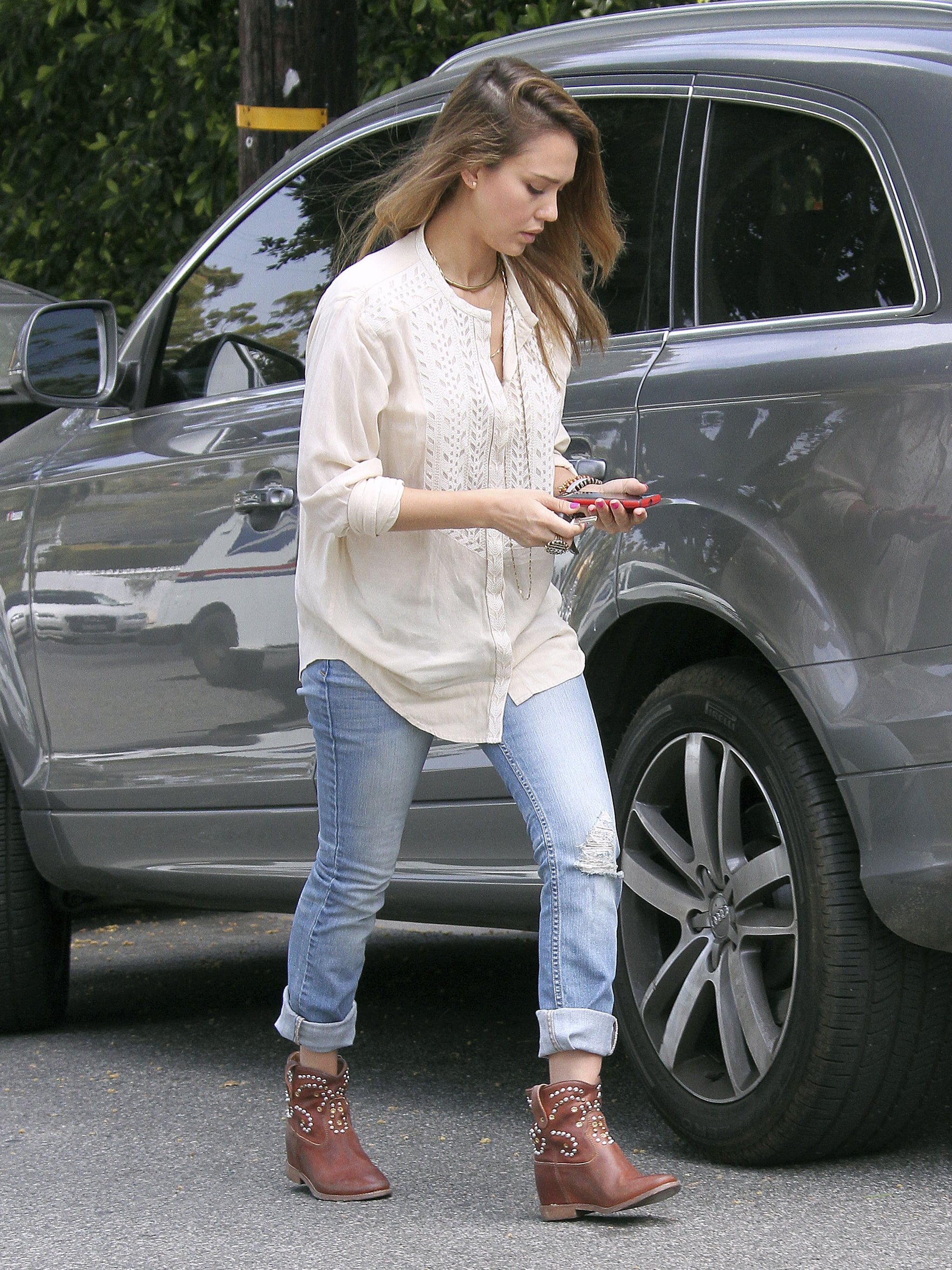 While running errands in Santa Monica, Alba showed a little country flavor in a gauzy button-down, cuffed denim, and studded cowboy boots by Isabel Marant.