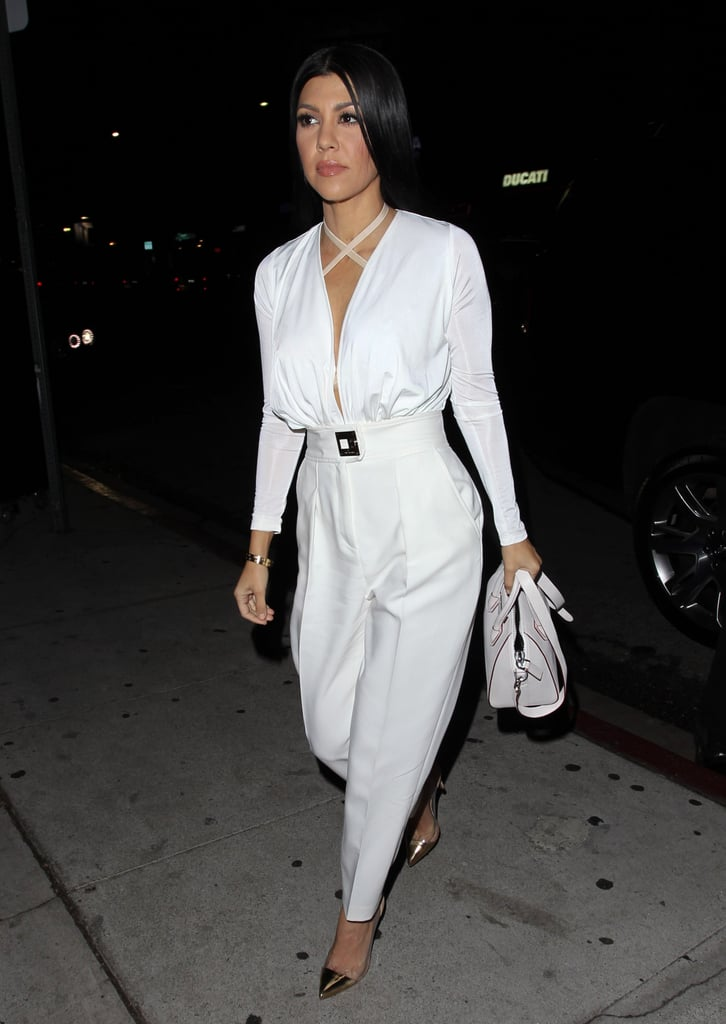 Just when you thought Kourtney Kardashian couldn't get any hotter, she does. On Friday, the reality TV star was spotted out in LA, rocking an all-white ensemble and looking better than ever! Despite her split from longtime boyfriend Scott Disick in July, Kourtney isn't letting a breakup get in the way of her sexy streak. Just last month, the mother of three made a handful of flawless appearances, including Jessica Alba's Baby2Baby Gala and Variety and WWD's Stylemakers event in LA. She's also been killing the Instagram game with her collection of superhot snaps. Keep reading to see her latest outing, and then find out if you're the Kourtney of your friend group.